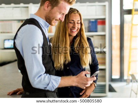 Handsome young couple working in office