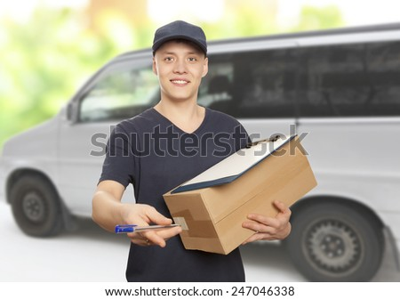 Handsome young delivery man portrait - stock photo