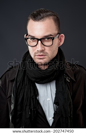 handsome young fashion man wearing scarf - stock photo