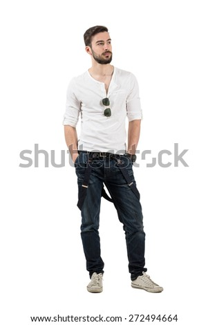 Handsome young fashion model confident looking away. Full body length portrait isolated over white background.  - stock photo