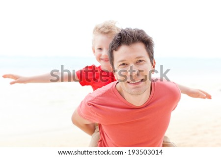 handsome young father and his little son playing together at the beach, tropical vacation, spending day together - stock photo
