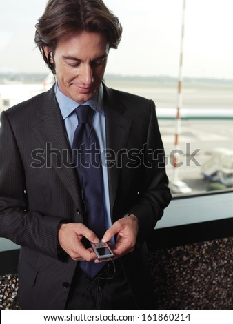 handsome young guy listening to favorite songs on the mp3 player