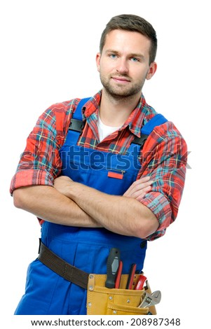 Handsome young handyman with arms crossed isolated on white background - stock photo