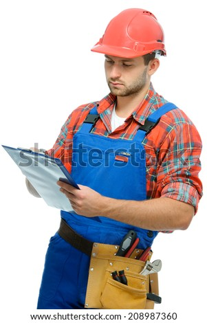 Handsome young handyman with clipboard isolated on white background - stock photo