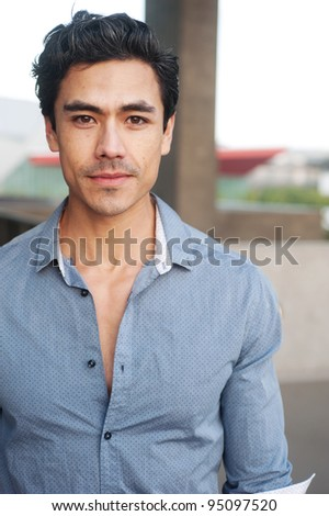 Handsome, young latino professional businessman