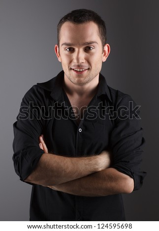 Handsome young male fashion model, in black shirt - stock photo