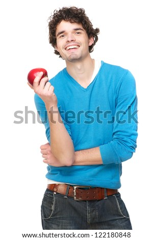 Handsome young male model holding a red apple with a friendly smile. Isolated on white background - stock photo