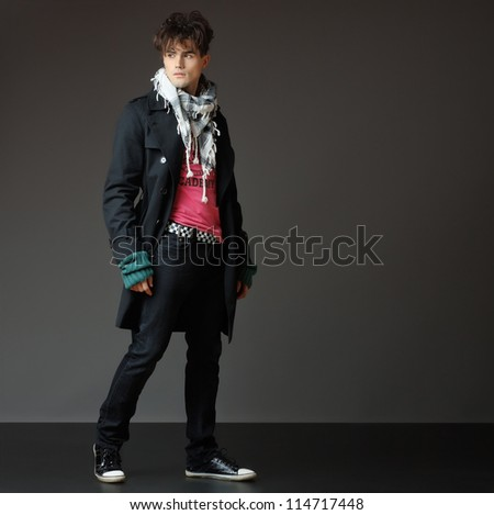 handsome young male model posing - studio shoot - copy space - stock photo