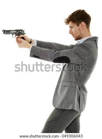 Handsome young man aiming the gun to an invisible target