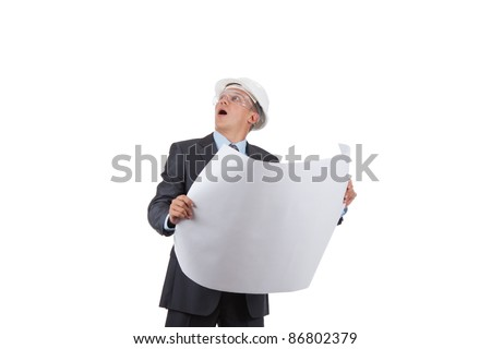 Handsome young man architect looking up with open mouth isolated over white background - stock photo