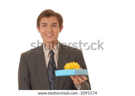 Handsome young man carrying a wrapped gift - stock photo