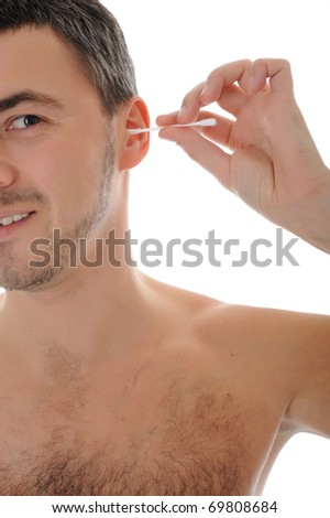 handsome young man cleaning ears with cotton pad stick. isolated on white background