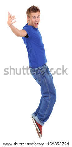 Handsome young man dancing isolated on white - stock photo