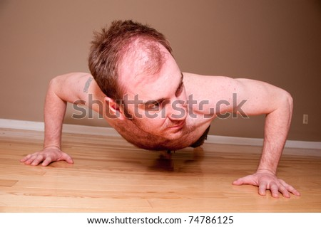 Handsome Young Man Doing Push ups - stock photo
