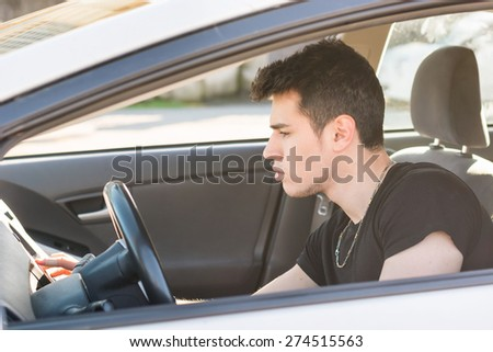 Handsome Young Man Driving a Car and playing music