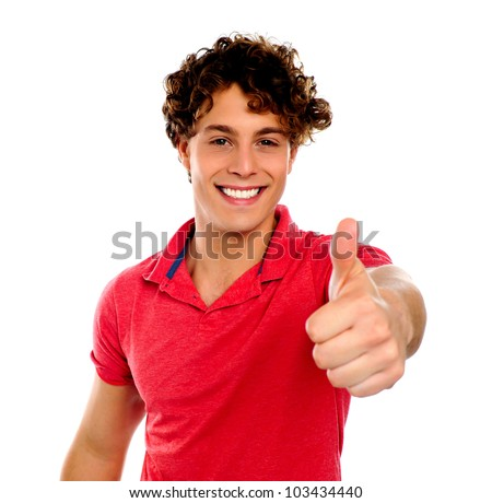 Handsome young man gesturing thumbs-up isolated on white