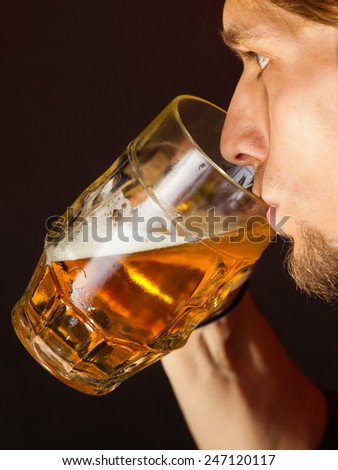 handsome young man guy drinking a glass of beer