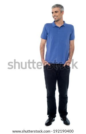 Handsome young man, hands in pockets - stock photo