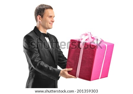 Handsome young man holding a big present isolated on white background