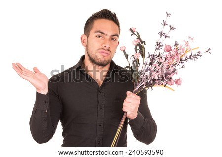 handsome young man holding a flower bouquet looking disappointed isolated on white - stock photo