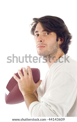 Handsome young man holding a football isolated over white