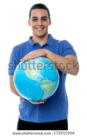 Handsome young man holding a globe on a white background