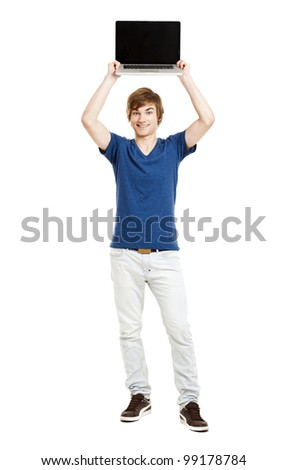 Handsome young man holding a laptop isolated over a white background - stock photo