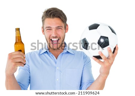 Handsome young man holding ball and beer on white background - stock photo