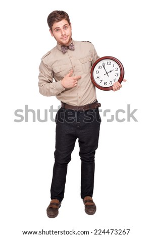 Handsome young man holding big clock, isolated on white background. Concept for lateness