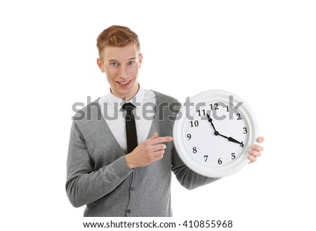 Handsome young man holding clock, isolated on white