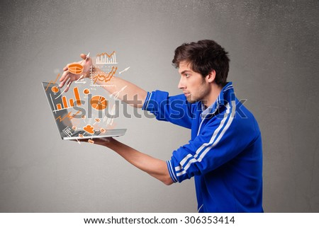 Handsome young man holding laptop with graphs and statistics - stock photo