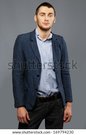Handsome young man in a blue shirt and jacket
