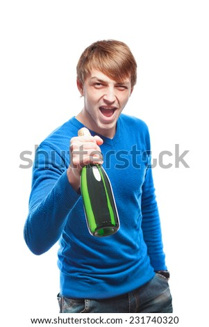 handsome young man in a blue sweater with a bottle of champagne isolated on a white background - stock photo