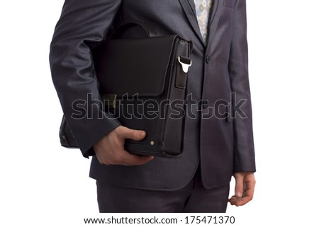 handsome young man in a business suit with briefcase