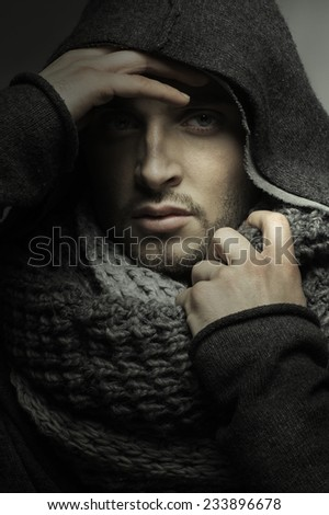 Handsome young man in a hood