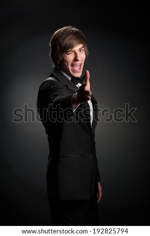 handsome young man in a strict black suit