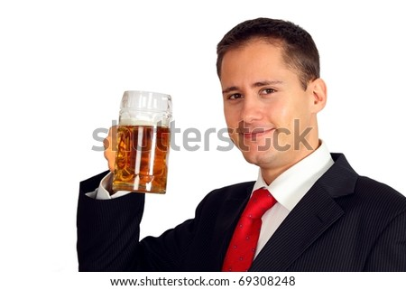 Handsome young man in a suit toasting with a beer - stock photo