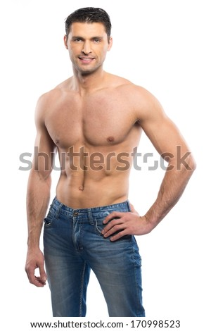 Handsome young man in blue jeans with naked torso
