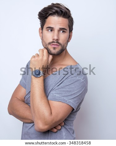 handsome young man in casual outfit - stock photo