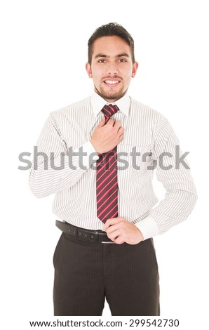 handsome young man in formal clothes fixing his red tie isolated on white - stock photo