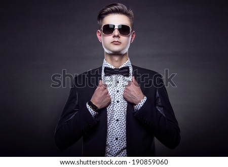 Handsome young man in stylish jacket. Office worker. Successful businessman - stock photo