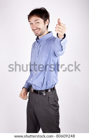 handsome young man in the blue shirt is stretched out his hand - stock photo
