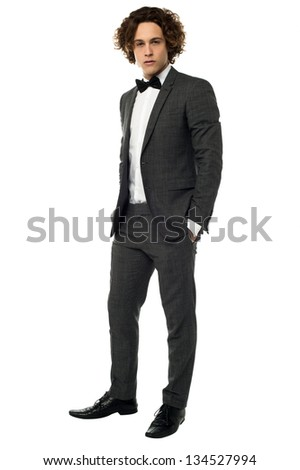 Handsome young man in wedding attire, full length portrait over white. - stock photo