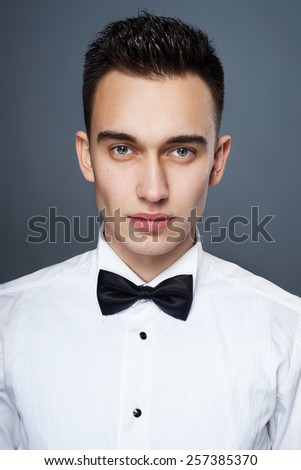 Handsome young man in white shirt  - stock photo