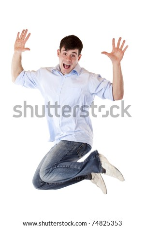 Handsome young man jumps in the air out of joy.Isolated on white background. - stock photo