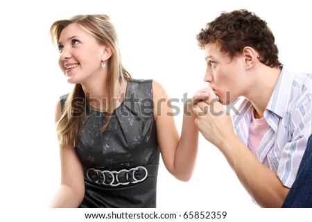 handsome young man kissing hand of his pretty girlfriend - stock photo