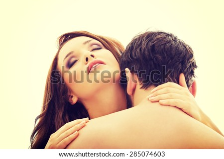 Handsome young man kissing woman's neck.