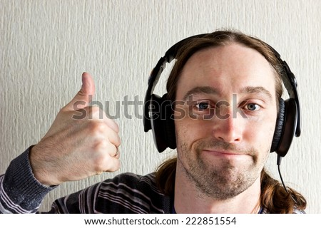 Handsome young man listen good music with headphones - stock photo