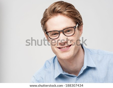 Handsome young man looking at camera - stock photo