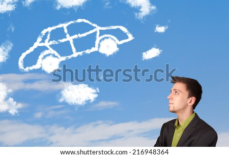 Handsome young man looking at car cloud on a blue sky - stock photo